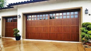 a clopay heritage garage door in natural wood staine